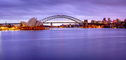 A Pre-dawn photo of Sydney Harbour, overlooking the Opera House and Harbour Bridge