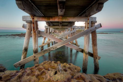 underneath La Perouse walkway over to Bare Island, NSW, Australia at Sunrise.