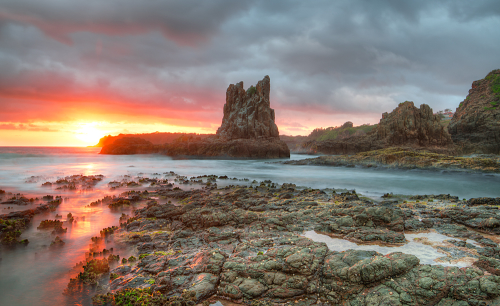 The stunning Cathedral Rocks at Kiama, lit up at sunrise