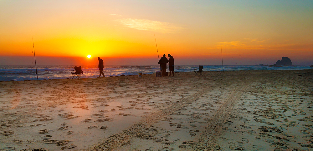 Fishermen setting up at daybreak on Surf Beach, Narooma. Australia