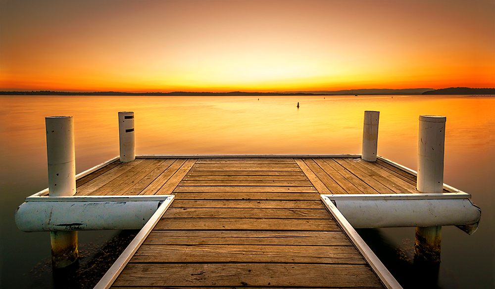 Spectacular sunset over Cams wharf, NSW lake Macquarie. Australia